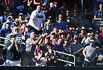 Fans try to come up with a foul ball during a spring training game in Scottsdale, Ariz., on Friday, March 18, 2016. <br />Photo by Cathleen Allison
