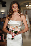 Model walks runway in bridal gown from the Oleg Cassini Weddings Spring Summer 2018 collection fashion show, at 15 East 63 Street on October 6, 2017; during New York Bridal Fashion Week.