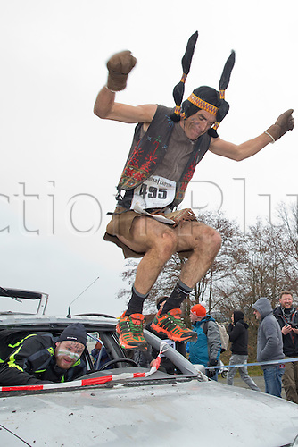 12.03.2016. Bischofsheim, Germany.  A participant of the extreme run Braveheart Battle wearing a Native American costume climbing an obstacle in Bischofsheim, Germany. Almost 2,700 runners have to manage a 30 kilometer track with 45 obstacles. The extreme run event leads through ice cold water, deep mud pits and hot fire obstacles. It is said to be one of the hardest in Europe.