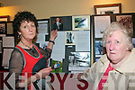 North Kerry Fiddle Photo Exhibition : Anna Mai Kelliher, Clandouglas, Lixnaw pointing ouy  a photo of her father Paudeen Kelliher,well known local musician ,to Kathleen Sheehy  in Parker's Bar in Kilflynn on Sunday last