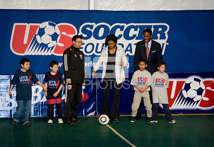 First Lady Michelle Obama participates in a drill during a US Soccer Foundation clinic held at City Center in Washington, DC.