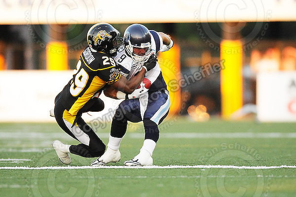 June 23, 2009; Hamilton, ON, CAN; Hamilton Tiger-Cats defensive back Lawrence Gordon (29) tackles Toronto Argonauts wide receiver Andre Talbot (9). CFL football: Toronto Argonauts vs. Hamilton Tiger-Cats at Ivor Wynne Stadium. The Argos defeated the Tiger-Cats 27-17. Mandatory Credit: Ron Scheffler. Copyright (c) 2009 Ron Scheffler.