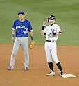 (L-R) Munenori Kawasaki (Blue Jays), Ichiro Suzuki (Yankees),<br /> AUGUST 20, 2013 - MLB :<br /> Ichiro Suzuki of the New York Yankees talks with shortstop Munenori Kawasaki of the Toronto Blue as he stands on second base in the ninth inning during the second game of their Major League Baseball doubleheader at Yankee Stadium in The Bronx, New York, United States. (Photo by AFLO)