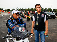 Aug 18, 2017; Brainerd, MN, USA; NHRA funny car driver John Force (left) talks with Papa Johns Pizza owner John Schnatter during qualifying for the Lucas Oil Nationals at Brainerd International Raceway. Mandatory Credit: Mark J. Rebilas-USA TODAY Sports
