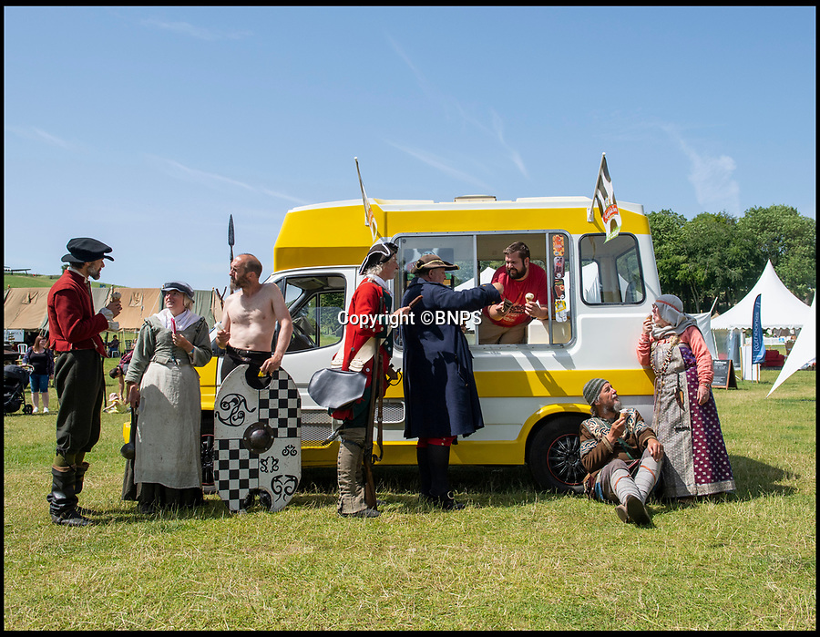 BNPS.co.uk (01202 558833)<br /> Pic: PhilYeomans/BNPS<br /> <br /> Even the living history actors at the Chalk Valley Festival in Dorset needed to cool down today as the temperatures soared to historical highs across Europe.<br /> <br /> The annual festival now in its 9th year brings experts from all over the UK to this Dorset field for a week of lectures and debate covering 2000 years of British history.