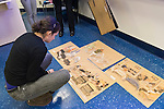 "Hempstead, New York, U.S. 12th November, 2013. Janet Hamlin, at back in black pants, a courtroom artist covering the military tribunals at Guantanamo Bay since 2006, shows her charcoal drawings and discusses her work at Hofstra University. A student is looking at sketches displayed on floor. Much of the time she was the only journalist providing a visual record of the events at the United States naval base in Cuba, and her new book ""Sketching Guantanomo"" is a collection of her images."