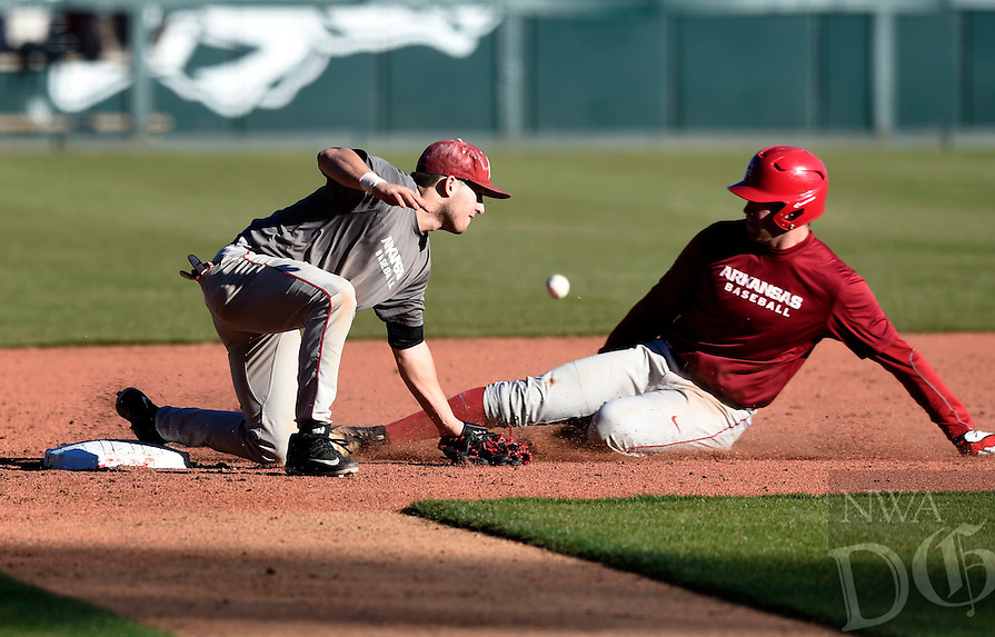NWA Democrat-Gazette/MICHAEL WOODS @NWAMICHAELW<br /> University of Arkansas baserunner Luke Bonfield (17) slides safely into third base as Matt Burch tries to make the tag Friday, January 27, during Arkansas Razorback baseball teams first practice for the 2017 season at Baum Stadium.