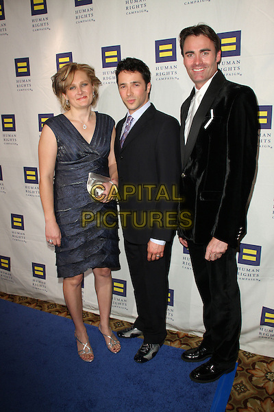 KELSEY BRAY, YUVAL DAVID & PARKER WILLIAMS.The Human Rights Campaign's Annual Los Angeles Gala & Hero Awards held at the Hyatt Regency Plaza Hotel, Century City, California, USA, .14th March 2009..full length black suit dress grey gray .CAP/ADM/KB.©Kevan Brooks/Admedia/Capital PIctures