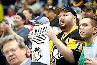 Fans hold up a sign during a tribute to Pascal Dupuis #9 of the Pittsburgh Penguins in the first period against the Washington Capitals during the game at Consol Energy Center in Pittsburgh, Pennsylvania on December 14, 2015. (Photo by Jared Wickerham / DKPS)