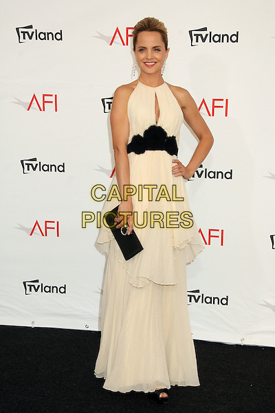 Mena Suvari.40th Annual AFI Life Achievement Award Honoring Shirley MacLaine held at Sony Pictures Studios, Culver City, California, USA..June 7th, 2012.full length dress black waistband tied layered layers white sleeveless clutch bag hand on hip.CAP/ADM/BP.©Byron Purvis/AdMedia/Capital Pictures.