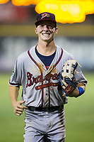 Danville Braves center fielder Drew Waters (12) jogs off the field between innings of the game against the Burlington Royals at Burlington Athletic Stadium on August 14, 2017 in Burlington, North Carolina.  The Royals defeated the Braves 9-8 in 10 innings.  (Brian Westerholt/Four Seam Images)