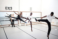 CAPE TOWN, SOUTH AFRICA - MARCH 6: Sikhumbuzo Hlahleni (center), age 15, trains jumps with other students at Cape Town City Ballet's youth company on March 6, 2010 in Cape Town, South Africa. He trains in Cape Town every Saturday. He also trains a few days week at home in Khayelitsha, a poor township outside Cape Town. (Photo by Per-Anders Pettersson).