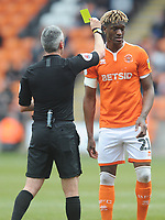 Blackpool's Armand Gnanduillet is shown a yellow card by referee Seb Stockbridge<br /> <br /> Photographer Kevin Barnes/CameraSport<br /> <br /> The EFL Sky Bet League One - Blackpool v Plymouth Argyle - Saturday 30th March 2019 - Bloomfield Road - Blackpool<br /> <br /> World Copyright © 2019 CameraSport. All rights reserved. 43 Linden Ave. Countesthorpe. Leicester. England. LE8 5PG - Tel: +44 (0) 116 277 4147 - admin@camerasport.com - www.camerasport.com