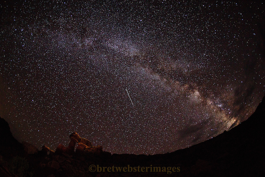 A shooting star decorates a serence moment in Shaeffer Canyon just outside of Canyonlands.