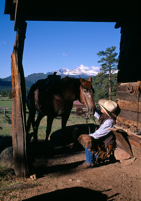 Cowboy having coversation with horse, MacGregor Ranch, Estes Park, CO