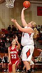 SIOUX FALLS, SD: DECEMBER 20: Michaela Mayer #54 from Washington lays the ball up for two points against Becky Frick #22 from Yankton in the the first half of their game Friday night at Washington. (photo by Dave Eggen/Inertia)