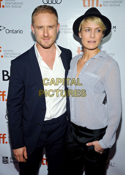 Ben Foster, Robin Wright<br /> &quot;Kill Your Darlings&quot; Premiere - 2013 Toronto International Film Festival held at Roy Thomson Hall, Toronto, Ontario, Canada.<br /> September 10th, 2013<br /> TIFF half length black suit white shirt grey gray trousers top hat  blouse silk satin   <br /> CAP/ADM/BPC<br /> &copy;Brent Perniac/AdMedia/Capital Pictures