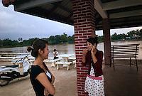 Pakse, Laos, August 18, 2007.Mobile phone romance...