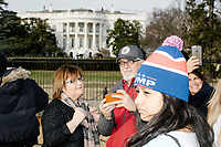 People gather outside the White House in Washington, D.C., on Jan. 19, 2017, the day before the inauguration of president-elect Donald Trump.