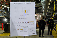 NYPD officers stand behind a Emergency Exit Plan sign at the new 34th Street-Hudson Yards terminal station on the 7 Subway line extension in New York on Friday, December 20, 2013. The new tunnel from Times Square, which will open in the Fall of 2014,  terminates 108 feet below street level at West 34th Street and Eleventh Avenue rat the doorstep of the rezoned 45 block Hudson Yards development. (© Frances M. Roberts)