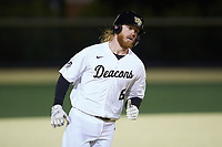 William Simoneit (8) of the Wake Forest Demon Deacons rounds the bases after hitting a walk-off solo home run in the bottom of the ninth inning against the Louisville Cardinals at David F. Couch Ballpark on March 7, 2020 in  Winston-Salem, North Carolina. The Demon Deacons defeated the Cardinals 3-2. (Brian Westerholt/Four Seam Images)