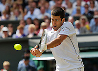 July 6, 2014, UK, London, Tennis, Wimbledon, AELTC, Men's Singles Final:  Novak Djokovic (SRB) vs Roger Federer (SUI), Pictured: Novak Djokovic in action<br /> Photo: Tennisimages/Henk Koster