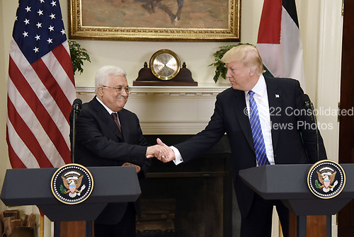 United States President Donald J. Trump shakes hands with President Mahmoud Abbas of the Palestinian Authority after a joint statement in the Roosevelt Room  of the White House in Washington, DC, on May 3, 2017. Photo by Olivier Douliery/ Sipa USA<br /> Credit: Olivier Douliery / Pool via CNP