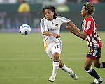 23 August 2007: Los Angeles's Cobi Jones (13) and Chivas's Lawson Vaughn (25) battle for the ball. Club Deportivo Chivas defeated the Los Angeles Galaxy 3-0 in a Major League Soccer regular season match at the Home Depot Center in Carson, CA.