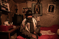 BOGOTA - COLOMBIA, 17-05-2020: Don Filiberto (90) sentado en su habitación, donde vive solo y corría el riesgo de ser desalojado. Mas de 200 familias terminan el proceso de desalojo en el predio La Estancia al sur de Bogotá quedando sin ninguna ayuda ni un techo donde vivir durante la cuarentena total en el territorio colombiano causada por la pandemia  del Coronavirus, COVID-19. / Don Filiberto (90) sitting in his room, where he lives alone and was at risk of being evicted. More than 200 families are evicted from La Estancia farm at south of Bogota city and they left withoput any help and shelter to live during total quarantine in Colombian territory caused by the Coronavirus pandemic, COVID-19. Photo: VizzorImage / Mariano Vimos / Cont