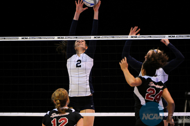 04 DEC 2010:  Cassie Haag (2) of Concordia St. Paul blocks the ball against Tampa during the Division II Women's Volleyball Championship held at Knights Hall on the Bellarmine campus in Louisville, KY.  Josh Duplechian/NCAA Photos