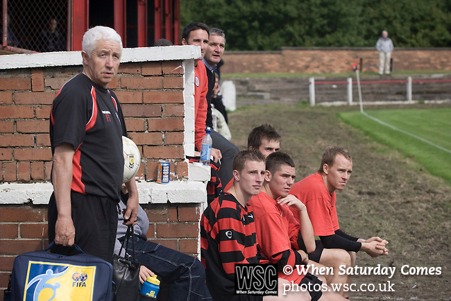 Kirkintilloch Rob Roy 1 Kilsyth Rangers 1, 16/08/2008. Adamslie Park, Sectional League Cup. Kirkintilloch Rob Roy backroom staff and substitute players watching their team (in red-and-black) taking on local rivals Kilsyth Rangers in a Sectional League Cup (Central) Section 8 tie at soon-to-be demolished Adamslie Park. The game ended in a 1-1 draw allowing Kilsyth to progress to the quarter-finals. Junior football was divided into East, West and North sections and played throughout Scotland. It had its own governing body, the SJFA and regional pyramid structure and national cup competition. Photo by Colin McPherson.