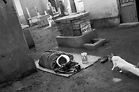 Cairo, Egypt, The City of the Dead, 1999 - Abdul Rassy naps next to a grave marker.