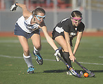(Worcester Ma 111613) Walpole 17, Sarah Rockwood,  and Longmeadow 18, Mary O'Reilly, reach for a loose ball in the second half, Walpole High would go on to win  the MIAA Division 1 Field Hockey Championship against Longmeadow High, Saturday, November 16, 2013, at Worcester Polytechnic Institute in Worcester.  (Jim Michaud Photo)  for Sunday