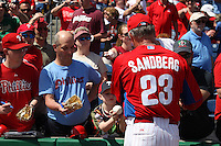 Philadelphia Phillies coach Ryne Sandberg #23 signs autographs before a spring training game against the Houston Astros at Bright House Field on March 7, 2012 in Clearwater, Florida.  (Mike Janes/Four Seam Images)