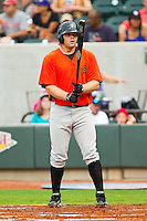 First baseman Aaron Baker #25 of the Frederick Keys checks his bat before stepping into the batters box against the Winston-Salem Dash at BB&T Ballpark on August 5, 2011 in Winston-Salem, North Carolina.  The Dash defeated the Keys 10-0.   Brian Westerholt / Four Seam Images
