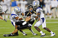 11 October 2008:  FIU wide receiver Greg Ellingson (82) is tackled by Middle Tennessee State cornerback Alex Suber (7) and safety Anthony Glover (8) in the FIU 31-21 victory over Middle Tennessee at FIU Stadium in Miami, Florida.