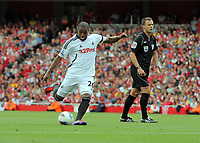 Pictured: Kemy Agustien of Swansea takes a shot off target from a free kick. Saturday 10 September 2011<br />