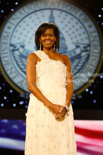 Washington, DC - January 20, 2009 -- First Lady Michelle Obama attends the Neighborhood Inaugural Ball at the Washington Convention Center on January 20, 2009 in Washington, DC. Obama became the first African-American to be elected to the office of President in the history of the United States. .Credit: Chip Somodevilla - Pool via CNP