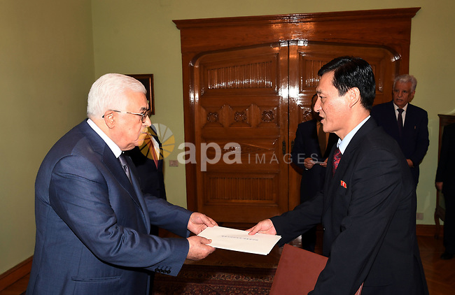 Palestinian President Mahmoud Abbas accepts the papers of the Ambassador of Korea to the State of Palestine in Cairo, Egypt, on July 8, 2017. Photo by Thaer Ganaim