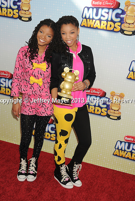 LOS ANGELES, CA- APRIL 27: Actresses Chloe Bailey and Halle Bailey arrive at the 2013 Radio Disney Music Awards at Nokia Theatre L.A. Live on April 27, 2013 in Los Angeles, California.