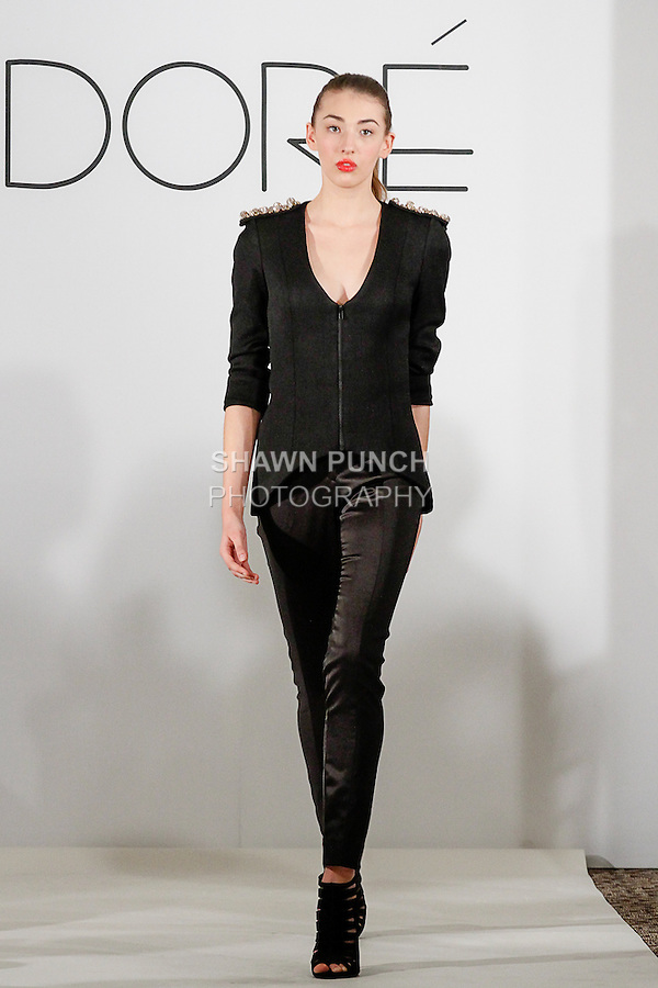 Model walks runway in an outfit from the Dore Designs 2014 collection by Dawn Smart, at the Crystal Room in the Empire Hotel during New York Fashion Week Fall 2014 on February 6, 2014.