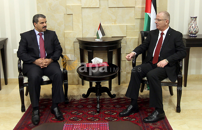 Palestinian Prime Minister, Rami Hamdallah, receives the annual report of the Office of Financial and Administrative Control in the West Bank city of Ramallah on May 11 , 2015. Photo by Prime Minister Offic