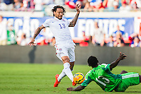 June 07, 2014:   the United States of America midfielder Jermaine Jones (13) tries to get past Nigeria defender Juwon Oshaniwa (13) during action between the USA Men's National Soccer team and Nigeria at EverBank Field in Jacksonville, Florida.  This is the last match before the USA team leaves for Brazil and the 2014 World Cup Championships. USA defeated Nigeria 2-1.
