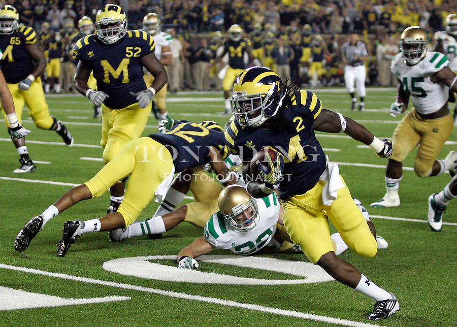 Michigan running back Vincent Smith (2) leaves Notre Dame safety Harrison Smith (22) behind to score on a 21-yard touchdown in the fourth quarter of an NCAA college football game, Saturday, Sept. 10, 2011, in Ann Arbor. Michigan won 35-31. (AP Photo/Tony Ding)