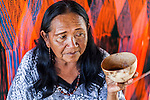 "An elderly Wayuu woman drinking ""tinto"" or sweet black coffee from a calabash cup in front of her loom.  Knitting, crocheting and weaving are fundamental to the social and economic lives of Wayuu women in La Guajira, Colombia."