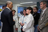 United States President Barack Obama talks with staff at Massachusetts General Hospital in Boston, Massachusetts, April 18, 2013. The President visited the hospital to meet with patients who were wounded in the bombings in Boston, following an interfaith prayer service at the Cathedral of the Holy Cross. .Mandatory Credit: Pete Souza - White House via CNP