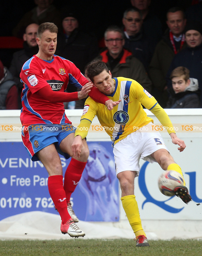 Pim Balkestein of AFC Wimbledon and Sam Williams of Dagenham - Dagenham vs AFC Wimbledon at the London Borough of Barking and Dagenham Stadium - 23/02/13 - MANDATORY CREDIT: Dave Simpson/TGSPHOTO - Self billing applies where appropriate - 0845 094 6026 - contact@tgsphoto.co.uk - NO UNPAID USE.