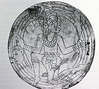 World Civilization:  Native American--Cahokia. Incised shell gorget--flying shaman, a death's head in one hand, ceremonial mace in another.