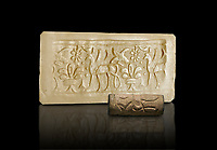 Hittite cylinder seal depicting a scene of animals, seal in foreground and impression standing behind.. Adana Archaeology Museum, Turkey. Against a black background