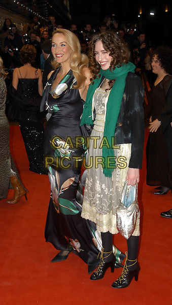 JERRY HALL & ELIZABETH JAGGER.BAFTA Awards arrivals.Odeon Leicester Square.www.capitalpictures.com.sales@capitalpictures.com.© Capital Pictures.bohemian dress, lace up boots, green scarf